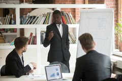 African american businessman gives presentation to partners work royalty free stock photos