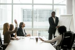 African-american businessman giving presentation answering quest. African american businessman giving presentation discussing project with multi-ethnic group at stock photo