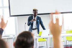 African american businessman giving presentation discussing project with multi-ethnic group at corporate training. Black teaching stock images