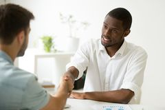 African-american businessman handshaking caucasian partner makin royalty free stock images