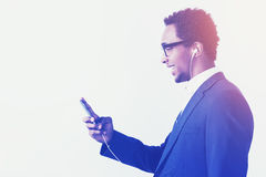 African American businessman in headphones is enjoying the playl Stock Images