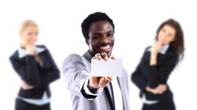 African American businessman holding a white card. Young African American businessman holding a white business card Royalty Free Stock Images
