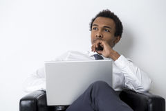African American businessman with laptop Stock Images