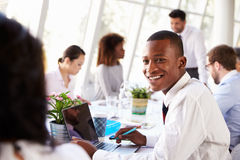 African American Businessman At Meeting With Colleagues Royalty Free Stock Image