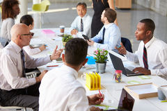 African American Businessman At Meeting With Colleagues Stock Images
