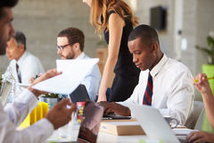 African American Businessman At Meeting With Colleagues Stock Photo