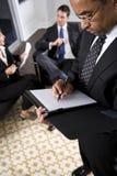 african american businessman notepad writing στοκ φωτογραφία