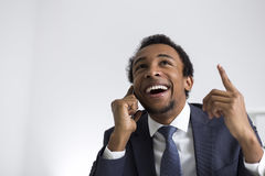 African American businessman on phone in office Royalty Free Stock Photos