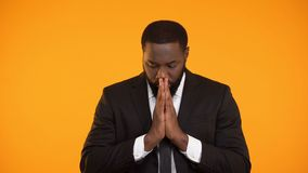 African-american businessman praying for successful deal, important meeting. Stock footage stock video