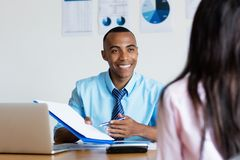 African american businessman presenting contact for new job. At office of business company royalty free stock photos