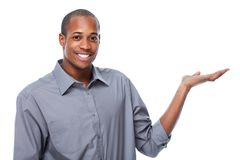 African-American businessman presenting copy space. Isolated white stock image