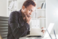 African american businessman reading book Stock Photography