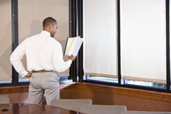 African American businessman reading document Royalty Free Stock Photography