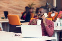 African American businessman sitting at the computer in his startup office Stock Images