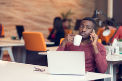 African American businessman sitting at the computer in his startup office Royalty Free Stock Photography