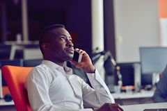 African American businessman sitting at the computer in startup office Royalty Free Stock Image