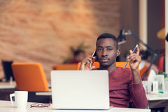 African American businessman sitting at the computer in startup office Royalty Free Stock Images
