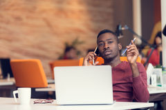 African American businessman sitting at the computer in startup office Royalty Free Stock Photo