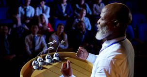 African American businessman speaking in business seminar in auditorium 4k