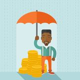 African-american businessman with umbrella as. An african-american businessman standing holding umbrella protecting his money to investments, money management Royalty Free Stock Photo