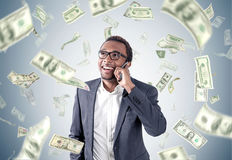 African American businessman under dollar rain royalty free stock image