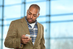 African American Businessman Using Cellphone Stock Image