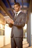 African American businessman using digital tablet Stock Photos