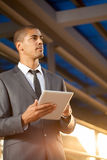 African American businessman using digital tablet Stock Photography