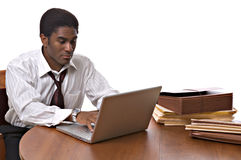 African-American businessman working on laptop Royalty Free Stock Photos