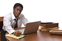 African-American businessman working on laptop Stock Image