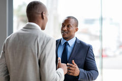 African american businessmen conversation. Successful african american businessmen having conversation in office stock images