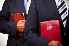 African American businessmen holding the Bible Stock Photography
