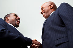 African American businessmen shaking hand isolated on white. African American businessmen making a deal shaking hands Royalty Free Stock Image