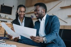 African american businesspeople discussing new business project. In cafe royalty free stock photography