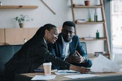 African american businesspeople discussing new business project. In cafe stock photography
