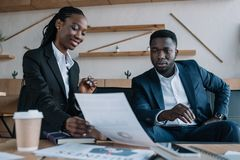 African american businesspeople discussing new business project. In cafe royalty free stock photo