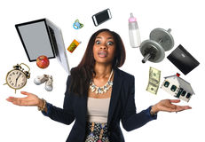 African American Businesswoman Juggling. Many objects and feeling overwhelmed Royalty Free Stock Photos