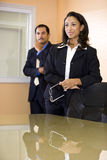African-American businesswoman with male co-worker Stock Photo