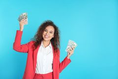 African-American businesswoman with money on color background stock photo