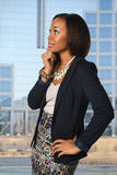 African American Businesswoman With Office Building in backgroun Stock Photo