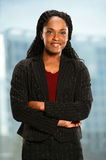 African American Businesswoman in Office. African American woman in front of office window with arms crossed Royalty Free Stock Photography