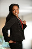 African American Businesswoman. Smiling with office in background Stock Images