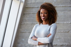 African American Businesswoman Standing Against Office Wall Stock Photo