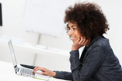 African American businesswoman using a laptop royalty free stock photo