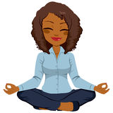African American Businesswoman Yoga. Young African American businesswoman in yoga lotus pose relaxing happy Stock Image