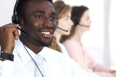 African american call operator in headset. Call center business or customer service concept.  stock photo