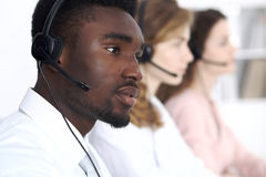 African american call operator in headset. Call center business or customer service concept.  royalty free stock image