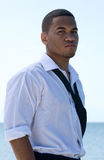 African american casual businessman. African american businessman stands near the water Royalty Free Stock Image