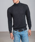 African-american casual man wearing black sweater and blue jeans. Stock Photography