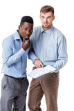 African-American and Caucasian businessman looking at documents Stock Image